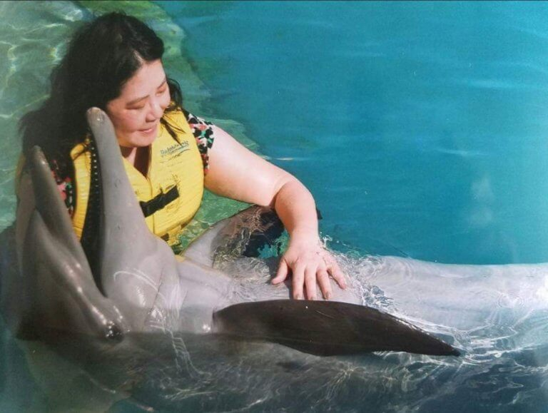 Reiki for a dolphin at Dolphinaris in Cozumel