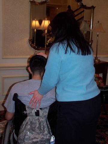 Claire doing reiki for wounded soldier at Walter Reed