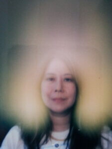 Claire's aura photo with a gold and pink aura. Reiki training has changed my aura and life.