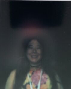 Claire's aura photo with red showing headache. Tired shown by darkness and lack of color