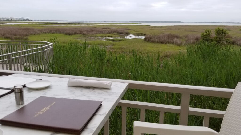 Outdoor dining at the hobbit - a beautiful view of the marsh and bay